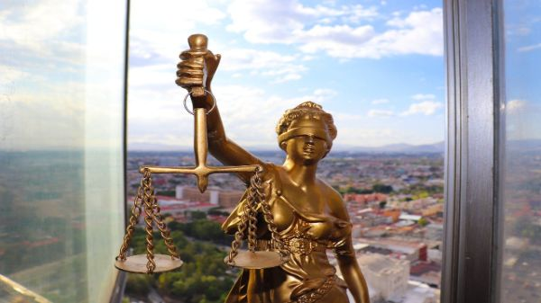 how to take legal action against company